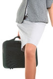 Woman  with a luggage. Business woman  with a luggage on white background Stock Photography