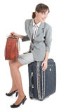 Woman  with a luggage. Business woman  with a luggage on white background Royalty Free Stock Photo
