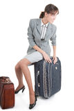 Woman  with a luggage. Business woman  with a luggage on white background Royalty Free Stock Photography