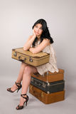 Woman and luggage. Stock Photos