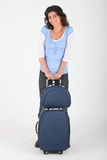Woman with luggage. On wheels Royalty Free Stock Images