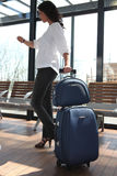 Woman with luggage Stock Photo