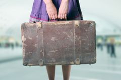 Woman with luggage at the airport Stock Photography