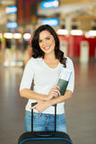 Woman luggage airport. Pretty young woman with luggage bag at airport Stock Photo