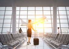 Woman with luggage in airport Royalty Free Stock Photo