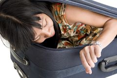 Woman in luggage checking time Stock Image