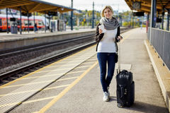 Woman With Luggage And Coffee Cup Waiting At Train Station Royalty Free Stock Photo