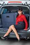 Woman in luggage compartment Stock Photos