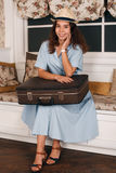 Woman with luggage get ready to travell. Royalty Free Stock Photos