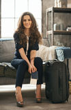 Woman with luggage in loft apartment waiting for departure Royalty Free Stock Images