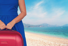 Woman with luggage ob beach Royalty Free Stock Images