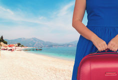 Woman with luggage ob beach Royalty Free Stock Image