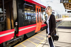 Woman With Luggage Standing At Train Station royalty free stock images