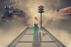 Woman with luggage waiting train on the platform of railway station Royalty Free Stock Photography