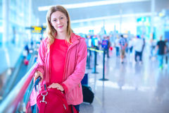 Woman with luggage Royalty Free Stock Image