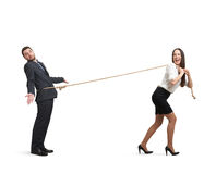 Woman lugging man Royalty Free Stock Photography