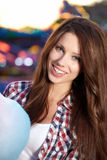 Woman in the lunapark. Woman with candy floss in the lunapark Royalty Free Stock Photography