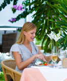 Woman at lunch. Young woman having lunch at terrace Stock Photography