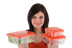 Woman with lunch boxes. Woman holding emty fplastic foot storage boxes royalty free stock photos