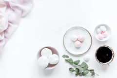 Woman lunch with marsh-mallow, coffee and flowers soft light on white table background flat lay mockup Stock Photos