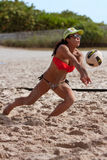 Woman Lunges To Pass Ball In Miami Beach Volleyball Game Stock Photography