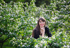 Woman in the lush spring garden Stock Images