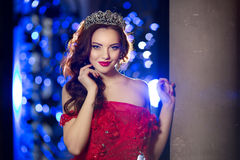 Woman in lux dress with crown like queen, princess, lights party Royalty Free Stock Photos