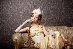 Woman in a luxurious vintage style Stock Images