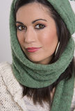 Woman Well Proportioned Face Smiling at Camera. Beautiful Brunette wrapped up to stay warm Royalty Free Stock Image