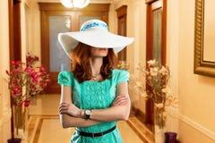 Woman in luxury corridor Stock Photo
