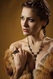 Woman in luxury fur coat Stock Images