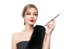 Woman in luxury fur. Retro style. White background Royalty Free Stock Photography