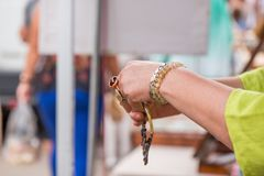Woman with luxury gemstone rings and bracelets selling expensive jewelry stock photo