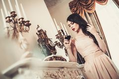 Woman in luxury house interior Royalty Free Stock Images