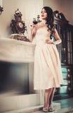 Woman in luxury house interior Stock Photos