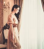Woman in luxury house interior Stock Images