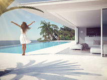 Woman in luxury resort near the swimming pool. 3d rendering Stock Photo