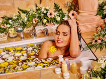 Woman at luxury spa. Woman relaxing at luxury water flower spa Stock Photography