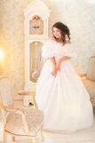 Woman in luxury vintage dress standing in bright room Royalty Free Stock Photos