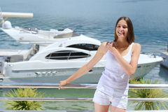 Woman on luxury yacht Stock Photo