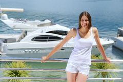 Woman on luxury yacht Stock Images