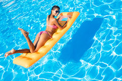 Woman lying on air mattress in the swimming pool Royalty Free Stock Photography