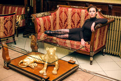 Woman lying on the antique sofa Royalty Free Stock Image