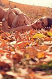 Woman lying in Autumn forest  Stock Photography