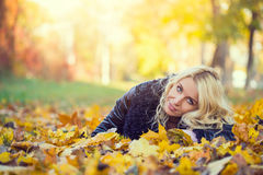 Woman lying in the autumn park Stock Image