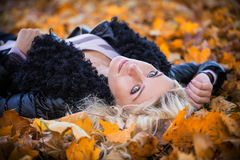 Woman lying in the autumn park Royalty Free Stock Image