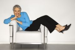 Woman lying back on chair. Royalty Free Stock Photography