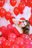 Woman lying in the balloon Stock Photos