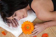 Woman lying on bamboo mat at spa Royalty Free Stock Photo