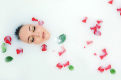 Woman lying in bath Stock Photos